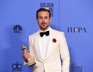 Ryan Gosling- Old Hollywood Glam No matter how many times I look and re-look at Ryan Gosling's pictures from the Golden Globes, I cannot close that tab without a deep sigh. It's quite a do-able look guys, I suggest you book-mark it. The whole look is monochromatic, yet the surprise element of white on white makes it stand out. Velvet is in, and hence the bow-tie. And that dash of red on his pocket – so charmingly old-Hollywood! I couldn't miss how cute his nicely manicured stubble looks.